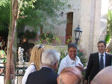 Vassula with Mr. Akel Biltaji on her right in the gardens of St. Margaret's, Nazareth